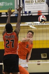 Northeastern's Nate Wilson hits around the block of Prince Gabriel in a PIAA Class 3A boys' volleyball state semifinal Tuesday, June 4, 2019 at Red Lion. Wilson, a member of the class of 2020, has committed to play volleyball at Ohio State University.