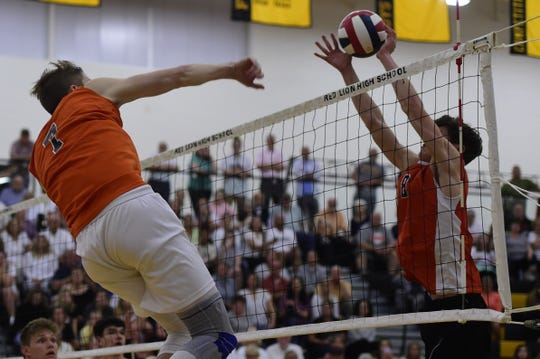Northeastern's Alex Finch hits the ball as Central York's Brock Anderson deflects the hit in a PIAA Class 3A boys' volleyball state semifinal Tuesday, June 4, 2019 at Red Lion.