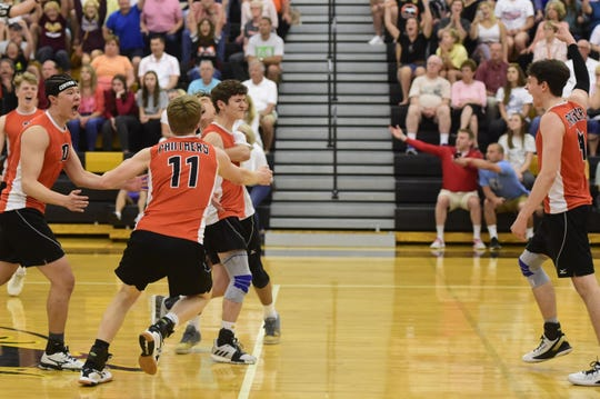 Central York's players crowd around setter Brock Anderson after winning a point in a PIAA Class 3A boys' volleyball state semifinal Tuesday, June 4, 2019 at Red Lion.