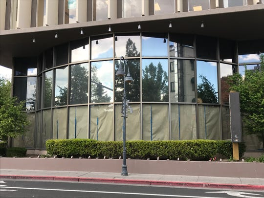 At Arlington Towers, the triple height bay window fronting West First Street is partly papered over to shield work being done for Hookava hookah lounge and bar.