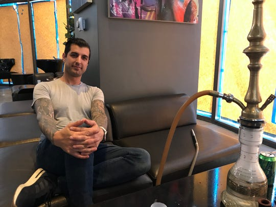 Batuhan Zadeh, owner of Hookava, takes a moment in the Arlington Towers space the hookah lounge is scheduled to move into in July 2019.