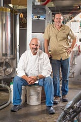 Chef David Silverman, seated, and Trent Schmidt, owners of the Silver Peak brewery and restaurants, are shown in 2014 as Silver Peak celebrated its 15th anniversary.