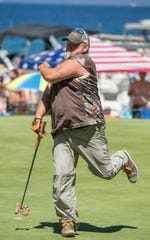 Larry The Cable Guy reacts after missing a putt on the 17th hole during the American Century Championship at Edgewood Tahoe Golf Course last July.