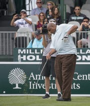 Charles Barkley tries to tee off with one hand on the 17th hole during the American Century Championship at Edgewood Tahoe Golf Course on July 13, 2017.