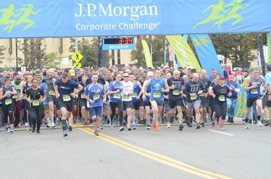 Runners in the second group start their 3.5 mile race at the J.P. Morgan Corporate Challenge on June 4, 2019 in Downtown Rochester.
