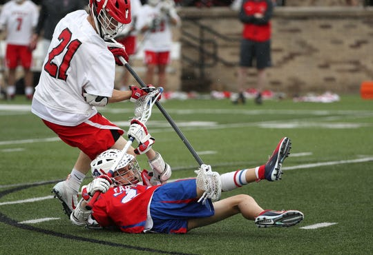 Fairport's Kole Stuver fights for control of the ball while on the ground as Baldwinsville's Cameron Sweeney applies pressure during Wednesday's state Class A semifinal at St. John Fisher College.
