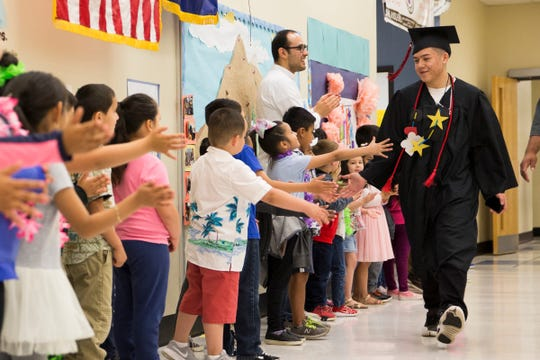 North Salem High School graduating seniors visit their home elementary school for a parade of honor at Mary Eyre Elementary School in Salem on June 5, 2019. The visit helps support the new graduates and is meant to inspire the younger generation as well.