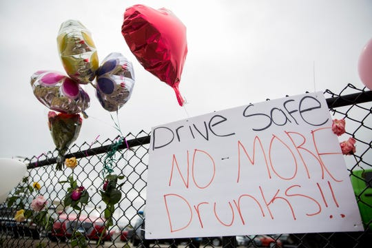 A memorial is shown set up by friends and family for Makayla Tryon, 18, of Keizer, Madison Capobianco, 19, and Trinity Watt, 19, both of Salem near the intersection of Cherry Avenue and Salem Parkway on June 5, 2019.