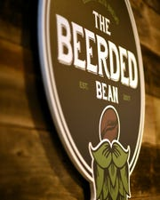 The Beerded Bean logo hangs on the wall at the back of the store. June 5, 2019.