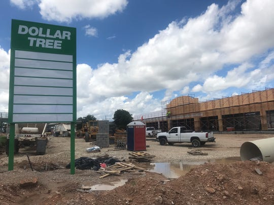 Construction workers build a new Dollar Tree on 2918 S. Bryant Blvd., Tuesday, June 4, 2019.