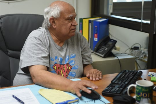 Pittsville Town Manager Joe Mangini checks his email, sitting in his office on Monday afternoon, June 3, 2019.