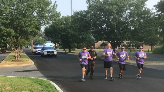 Law enforcement officers from Virginia's Eastern Shore ran the first lap of the 2019 Torch Run benefitting the Special Olympics Virginia in Chincoteague, Virginia on Wednesday, June 5, 2019.