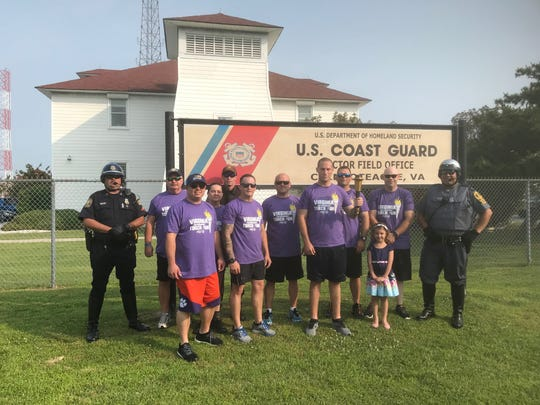 Law enforcement officers participate in the first leg of the Eastern Shore of Virginia leg o the 2019 Virginia Special Olympics Torch Run on Wednesday, June 5, 2019 in Chincoteague, Virginia.