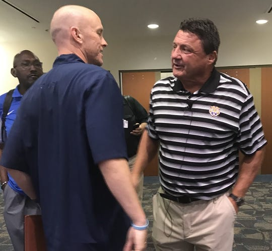 Airline coach Bo Meeks visits with LSU coach Ed Orgeron prior to the start of Wednesday's LHSCA Convention in Shreveport.
