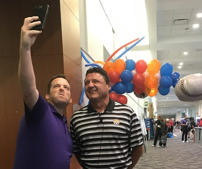 Craig Leaumont of New Orleans gets a shot with LSU coach Ed Orgeron Wednesday during the LHSCA Convention in Shreveport.