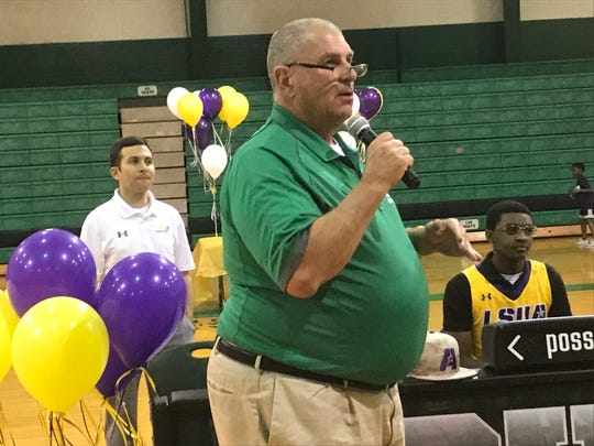 Bossier principal David Thrash talks about Kaalas Roots during a signing event Tuesday at the school while Roots and LSUA coach Larry Cordaro look on.