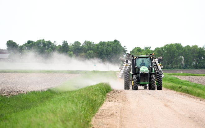 A local farmer drives out to the field for late-season planting Tuesday, June 4.