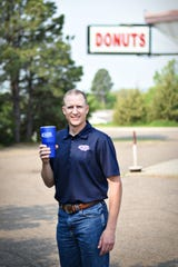South Dakota Retailers Association Executive Director Nathan Sanderson stands outside The Donut Shop in Pierre.