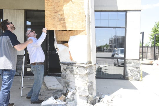 A car collided with the entrance of 22Ten Kitchen Cocktails on 69th Street on Wednesday around 1 p.m.