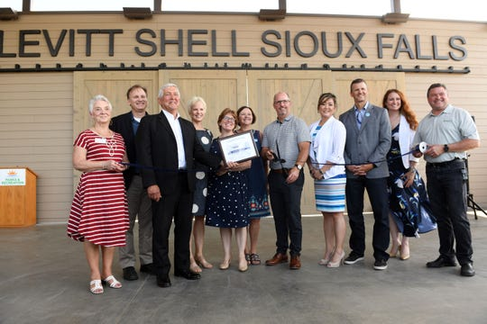 Contributors to the Levitt at the Falls project stand before cutting the ribbon on the finished venue Wednesday, June 5, in Sioux Falls.
