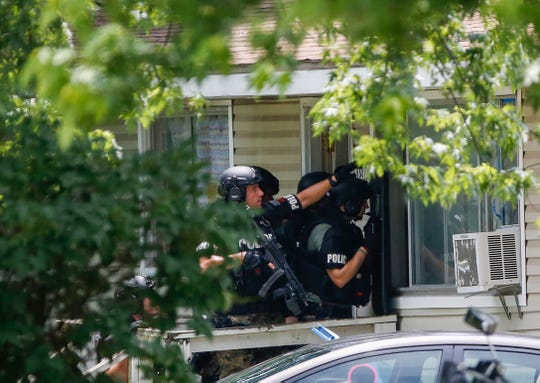 Police respond to a scene on North Oak Grove Avenue for a reported shooting on Wednesday, June 5, 2019.