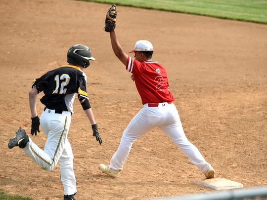 Riverheads' Michael Robertson stretches to record the out at first base in his team's win over Colonial Beach Tuesday.