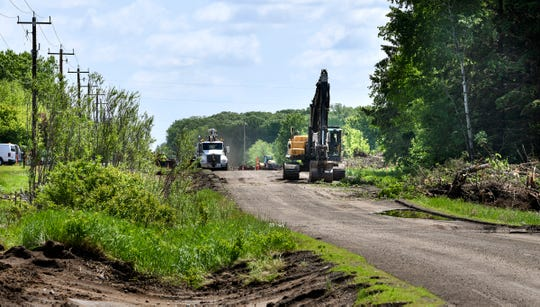 Construction crews work on a street project Wednesday, June 5, on 33rd Street South in St. Cloud.