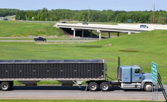 Traffic uses ramps to exit Interstate 94 at the intersection with Minnesota Highway 23 Wednesday, June 5, south of St. Cloud.