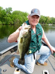 Wisconsin resident Gary Augustine holds a giant bass he caught on a wacky worm.