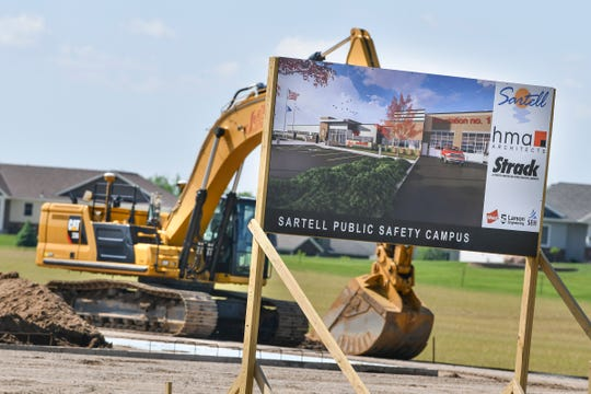 A sign includes an artist's rendition at the construction site for the new Sartell Public Safety Campus at 501 Pinecone Road S Wednesday, June 5, in Sartell.