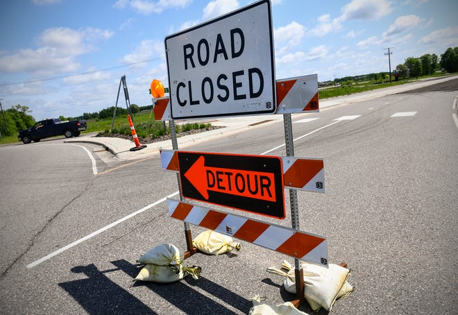 Signs are posted near the construction zone Wednesday, June 5, on 33rd Street South near the new Tech High School building in St. Cloud.  The state's recent increase in Local Government Aid can help cities cover costs related to roads and other projects.