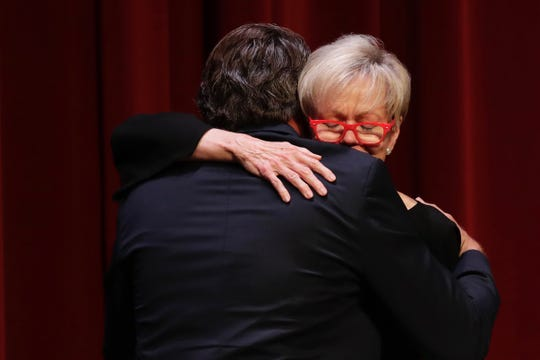 Patsy Palmer, widow of Sandy D'Alemberte, hugs her stepson Joshua D'Alemberte after she speaks at her late husband's memorial service at Ruby Diamond Concert Hall Wednesday, June 5, 2019.