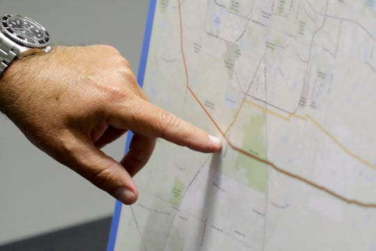 Gulf Power employee Meier Wise explains the company's newly proposed route of a transmission power line during a meeting held by NextEra with the public about the proposed project at the North Florida Fairgrounds Tuesday, June 4, 2019.