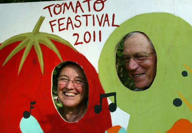 Louise Divine and Herman Holley, owners of Turkey Hill Farm, pose for a photo during their fourth annual Tomato Feastival in 2011. This year the festival moves to Goodwood Museum and Gardens.