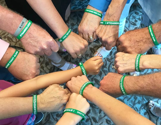 Family members and friends of Nick DiLuzio show off their wristbands in support of him during the event at TMH Cancer Center on Tuesday, June 4, 2019.