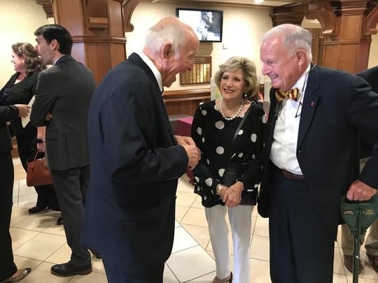 "Childhood friend of Sandy D'Alemberte's, Dubose ""Duby"" Ausley, far right, his wife, Sallie, center, chat with friends after 'Celebration of Life' for the former Florida State University President."