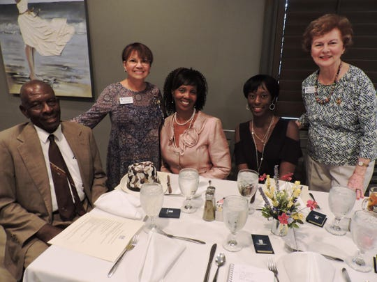 Melvin Dennis, left, Nidia Bernstiel, Women in Transition Award winner Gloriues Hartfield-Dennis, Live Your Dream Award winner Sabby Hightower and Mary-Jo Horton at the Soroptimist International of Stuart annual Awards Celebration.
