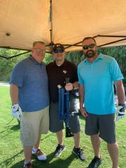 Doug Baber, left, Jeremiah Johnson and Jimmy Durante  at Fairwinds Golf Course for the fifth annual Dickerson Ultimate Drive Golf Tournament benefiting United Way of St. Lucie County.