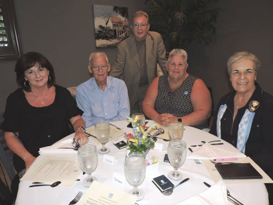 Donna Veight, left, Ken Austin, Joseph Veight, Paula Austin and Marie Kennedy at the Soroptimist International of Stuart annual Awards Celebration.