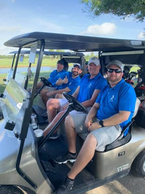 Scott Artman, left, Billy Chapman, Justin Seigler and Patrick Hilburn at Fairwinds Golf Course for the fifth annual Dickerson Ultimate Drive Golf Tournament benefiting United Way of St. Lucie County.