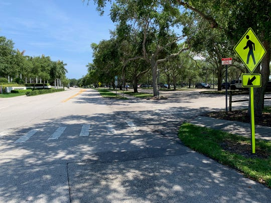 Here's what a motorist might see heading south into Vero Beach's Riverside Park from Beachland Boulevard. Signs like the small red one led to more than 200 parking tickets in Riverside Park March through May of 2019, according to city police.
