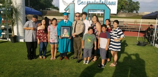 Juan Bravo graduated VCIS with Family and Tulare County Sheriff Mike Boudreaux by his side.