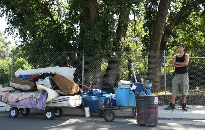 Matthew Gregory, 43, prepares to haul his belongings back to St. John's River after Visalia HOPE Team officers cleaned up homeless camps along Mill Creek Trail on Wed. June 5, 2019.