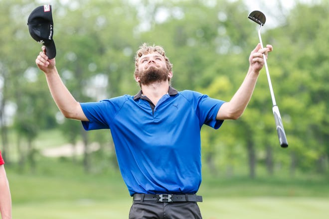 Merrill's Russell Dettmering celebrates after shooting a 66 in the final round of the WIAA Division 1 state golf tournament Tuesday at University Ridge in Madison.