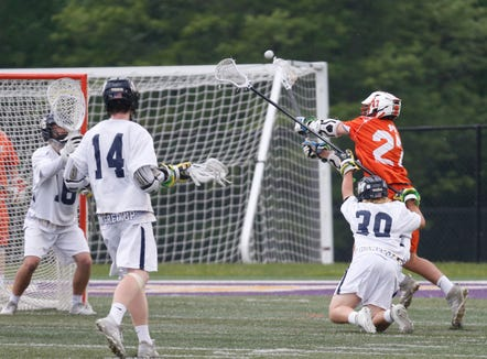 Mamaroneck's Grant Malas takes a shot on Massapequa's, goal during the Class A State Semi Final in Albany on June 5, 2019.