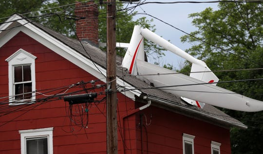 Danbury firefighters work at the scene of a small plane that crashed into a house at 5 Golden Hill Avenue in Danbury, CT. June 4,  2019. The pilot was able to self extricate from the plane and was taken to Danbury Hospital with minor injuries.