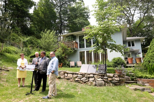 County Executive George Latimer discusses a new study to analyze the flight path and the noise from airplanes with homeowner Jeffrey Kuduk, right, Director of Operations Joan McDonald and Legislator Michael Kaplowitz June 5, 2019 in Chappaqua.