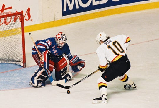 On this day 25 years ago New York Rangers goalie Mike Richter stops Vancouver Canucks Pavel Bure on a second period penalty shot during Game 4 of the Stanley Cup Finals at Pacific Coliseum in Vancouver British Columbia June 7, 1994. The Rangers went on to win Game 4 and eventually the Stanley Cup.