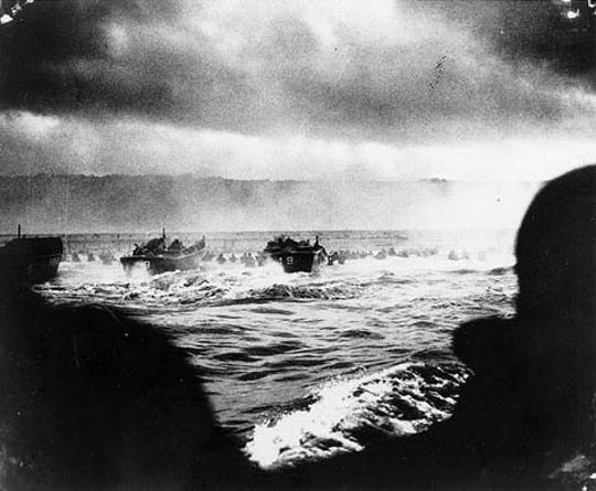 A convoy of US landing craft nears the beach during the Allied Invasion of Europe, on D-Day in Normandy, France, on June 6, 1944.