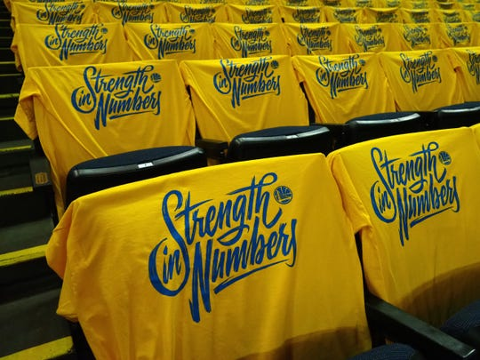 """""""Strength in Numbers"""" shirts the Warriors gave out for Game 1 of the 2018 NBA Finals."""